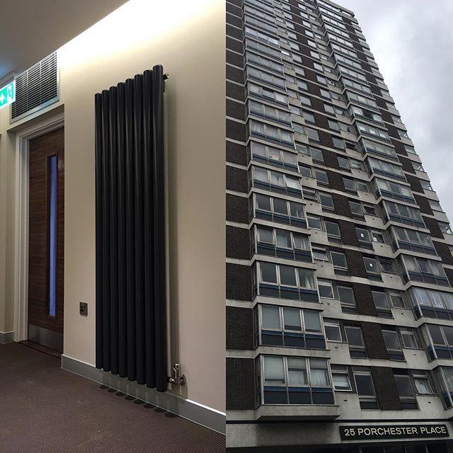 Вертикальный радиатор в подъезде многоэтажки