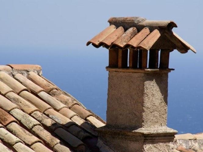 Какой высоты должна быть труба дымохода над крышей?